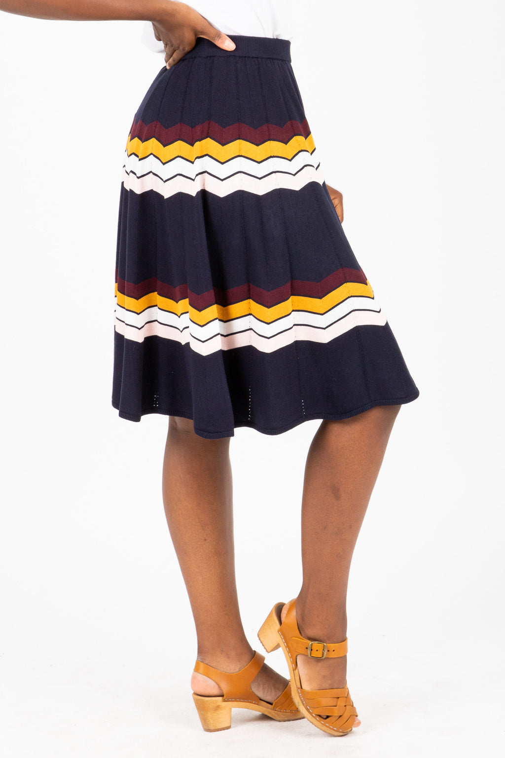 The Jenna Wave Knit Skirt in Navy, studio shoot; side view