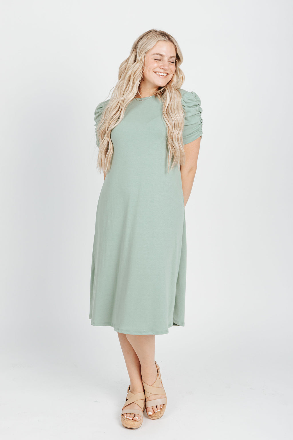 The Harrington Puff Sleeve Dress in Pistachio, studio shoot; front view