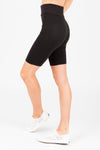 The Thick Knit Biker Short in Black, studio shoot; side view