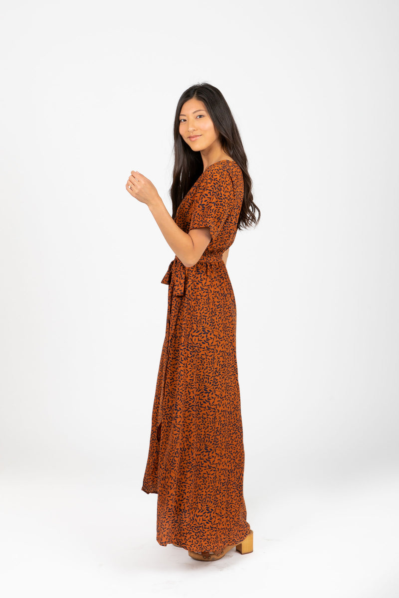 The Elise Patterned Wrap Dress in Rust, studio shoot; side view