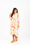 The Acuna Floral Wrap Dress in Blushy Peach