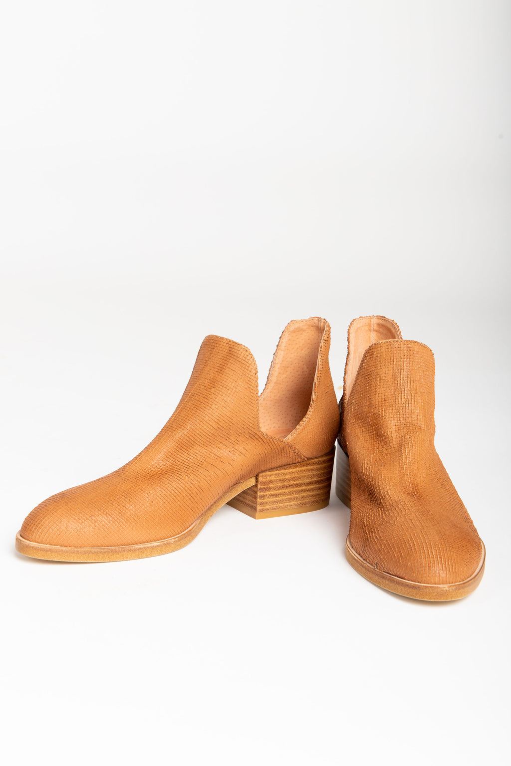 The Cecilia Cutout Bootie in Dark Tan Cut Leather, studio shoot; front view