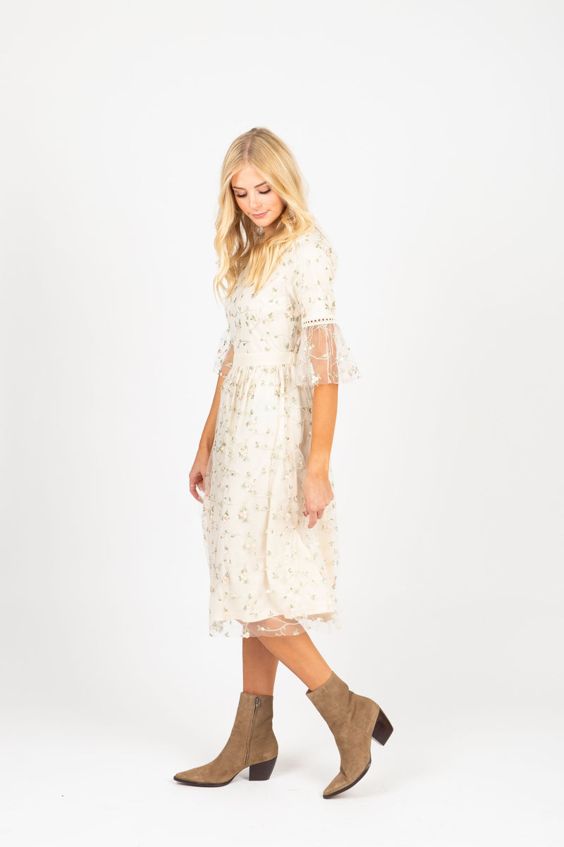 The Illusion Floral Delicate Lace Dress in Ivory, studio shoot; side view