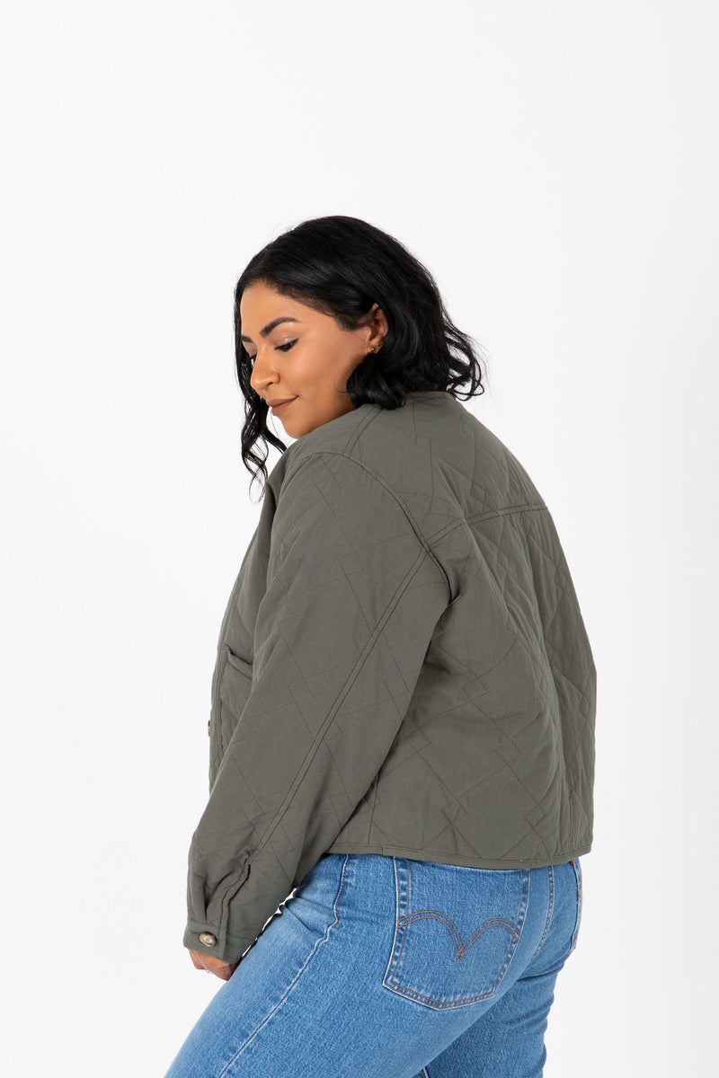 The Janine Quilted Jacket in Olive, studio shoot; side view