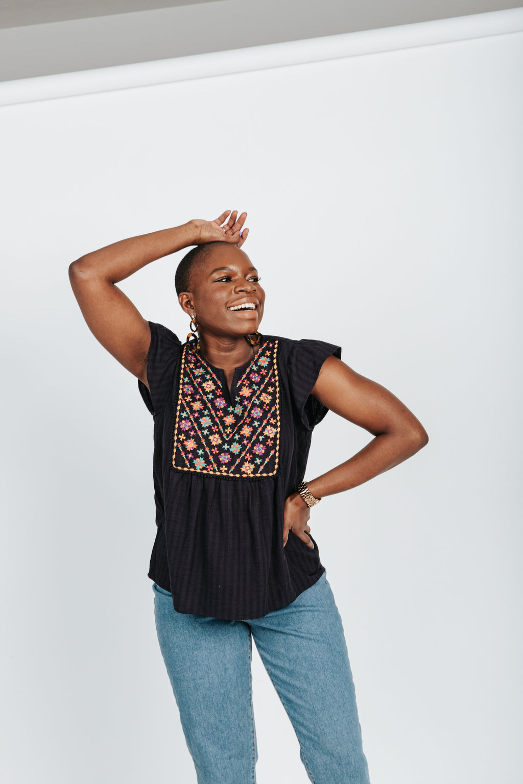 The Robbins Embroidered Detail Blouse in Navy, studio shoot; front view