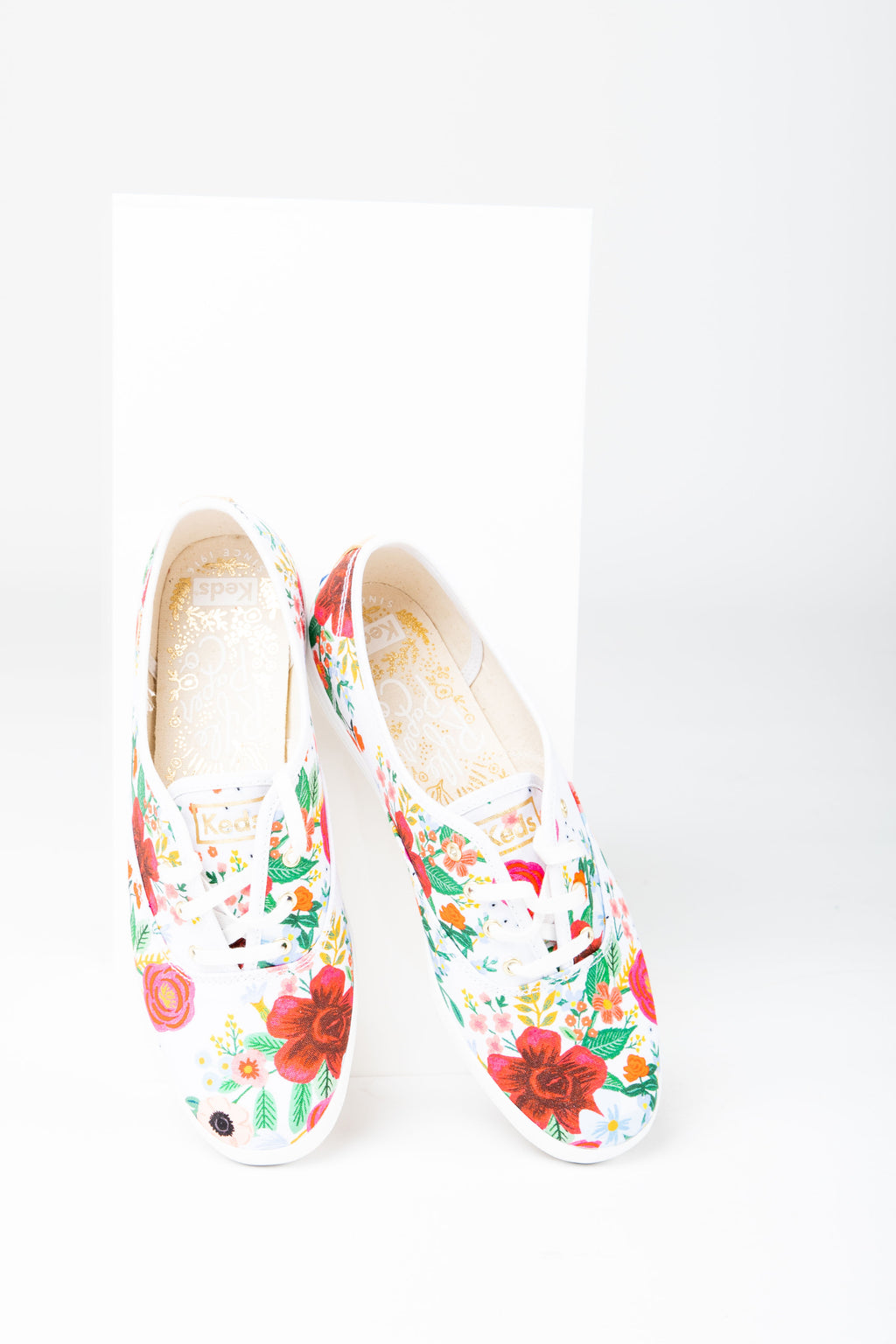 Keds: Rifle Paper Co. Champion Sneaker in Wildrose White, studio shoot; front view