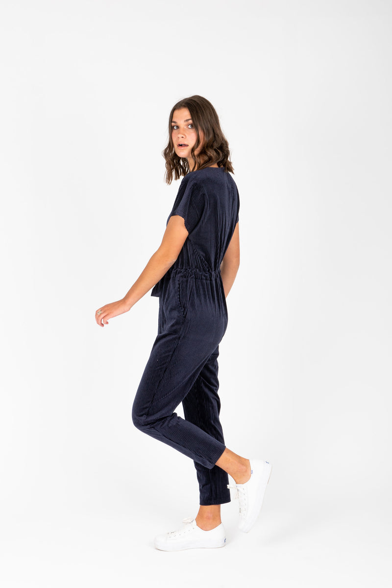 Piper & Scoot: The Bianca Cinch Jumpsuit in Ribbed Navy, studio shoot; side view