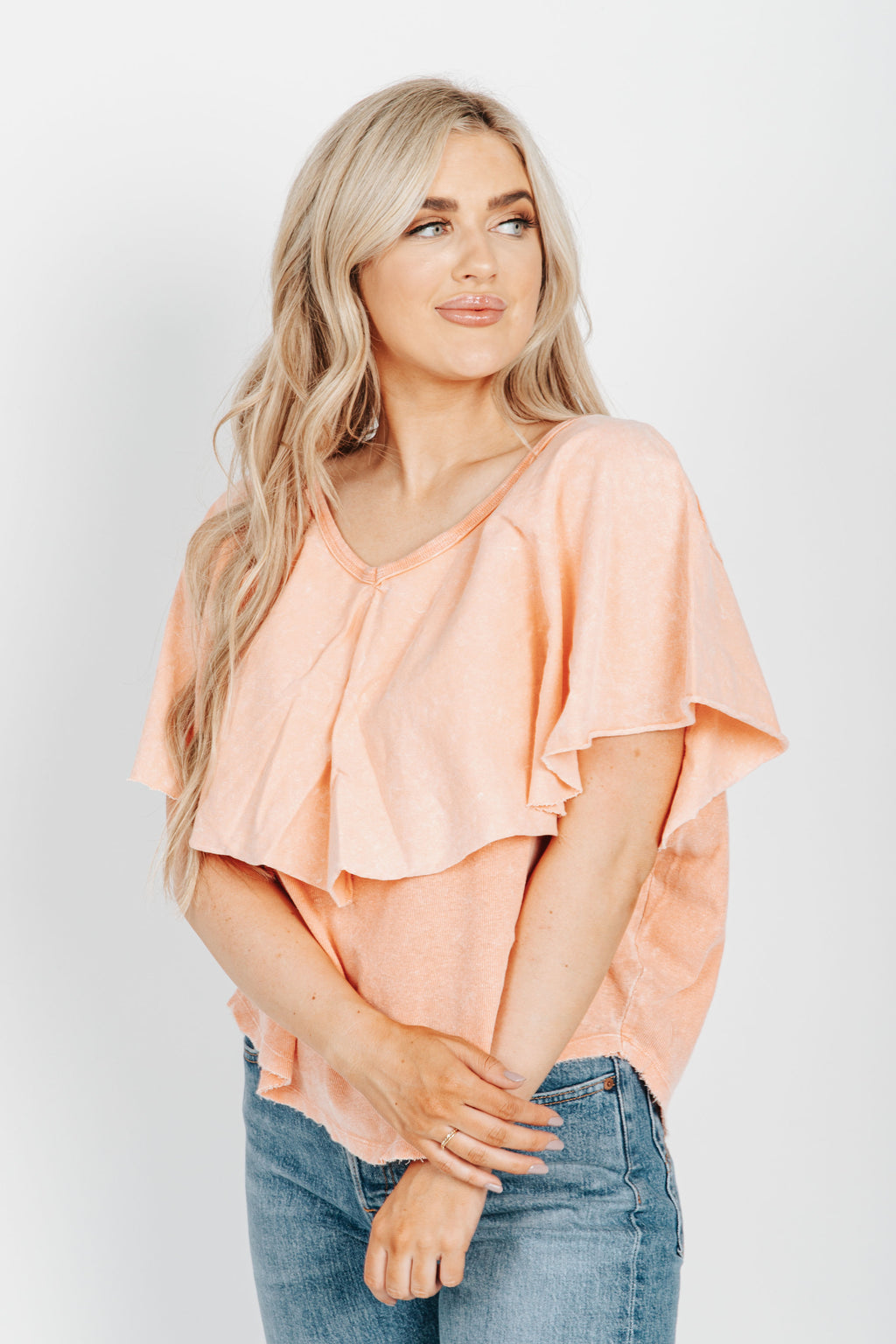 Free People: Girl Talk Tee in Sunny Peach, studio shoot; front view