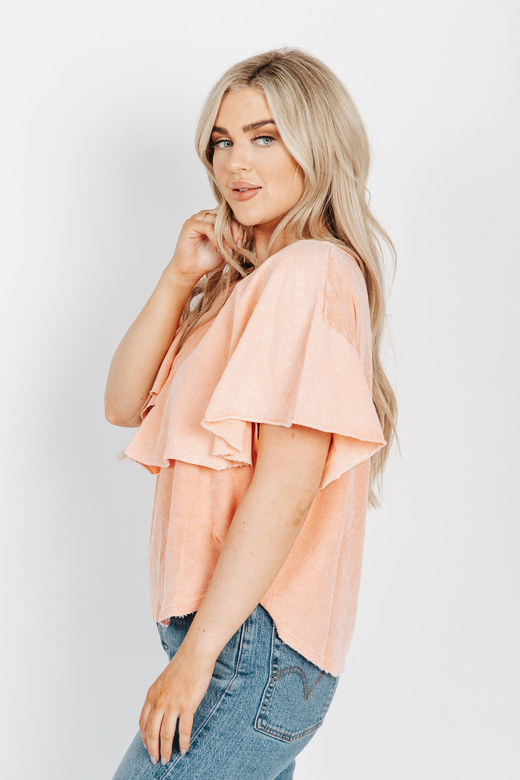 Free People: Girl Talk Tee in Sunny Peach, studio shoot; side view