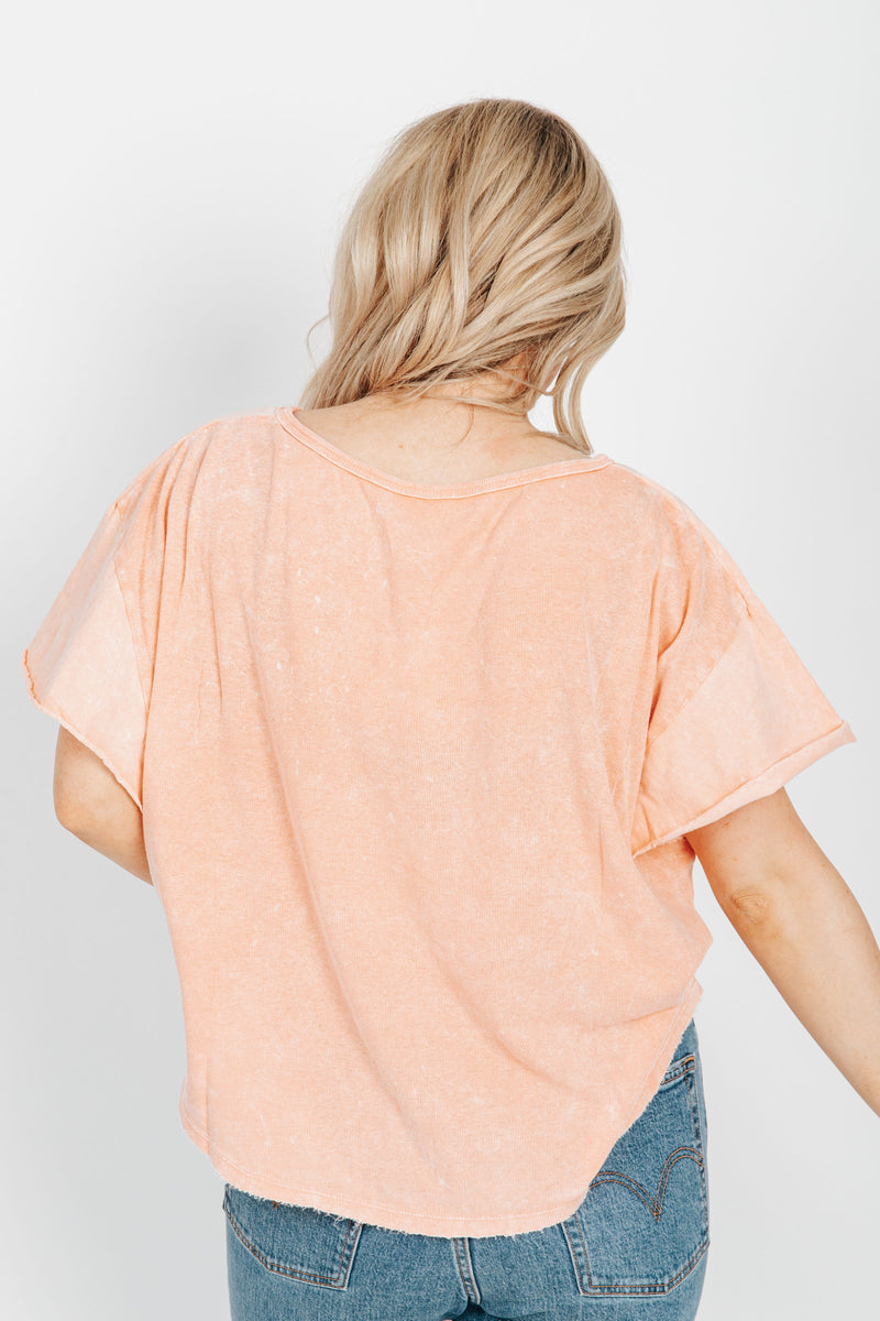 Free People: Girl Talk Tee in Sunny Peach, studio shoot; back view