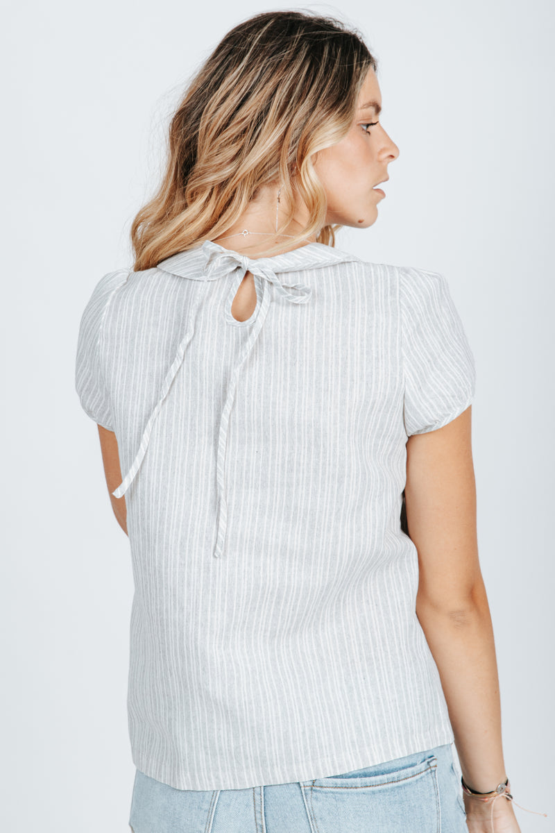 The Wendy Button Up Collar Blouse in Heather Grey, studio shoot; back view