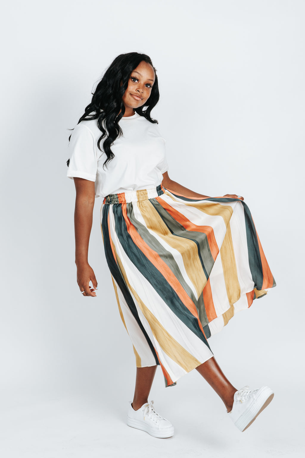 The Hans Striped Skirt in Multi, studio shoot; side view