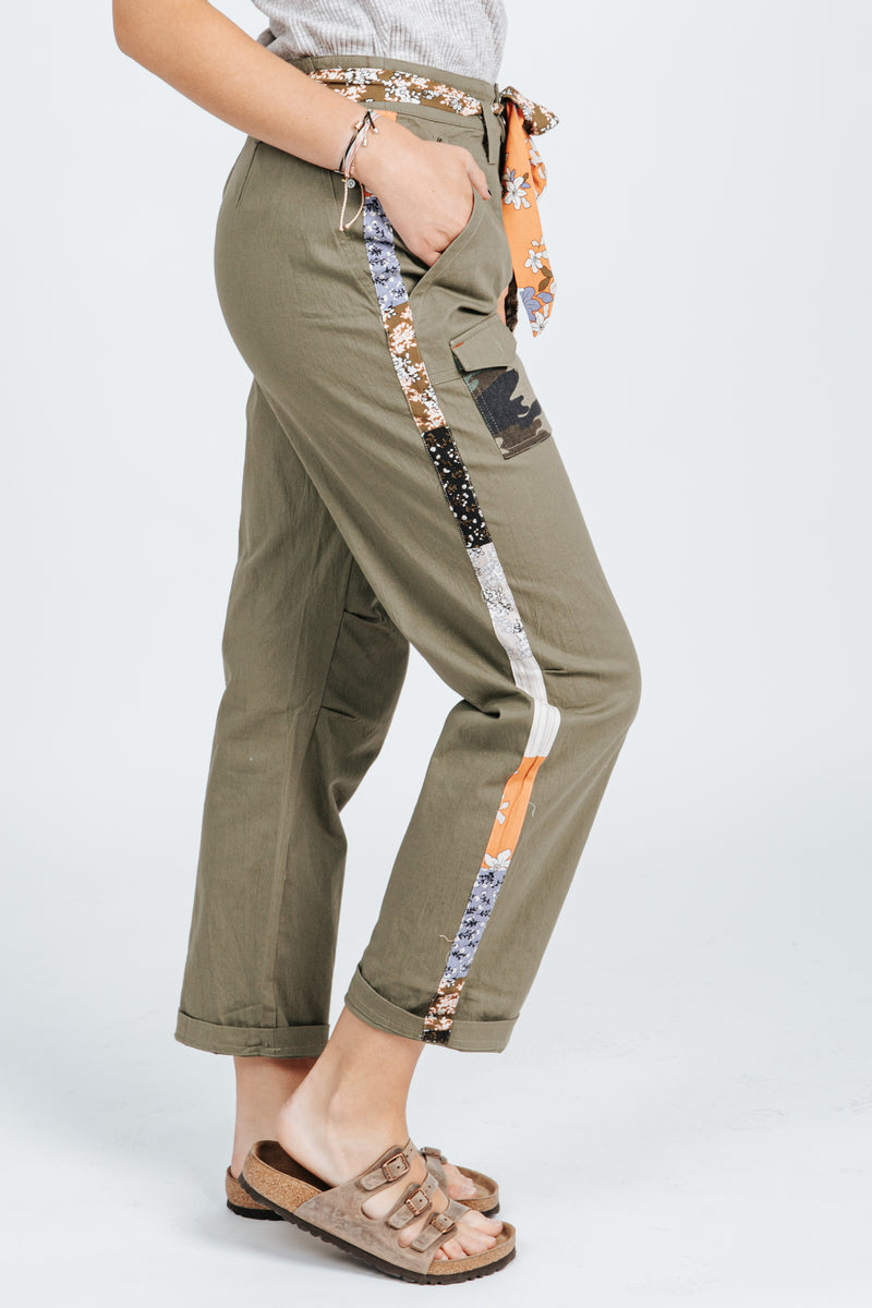 The Tori Utility Pant in Olive, studio shoot; side view