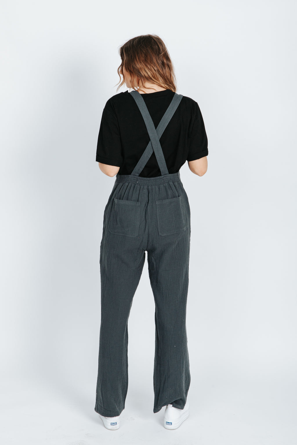 The Katey Tank Jumpsuit in Charcoal, studio shoot; back view