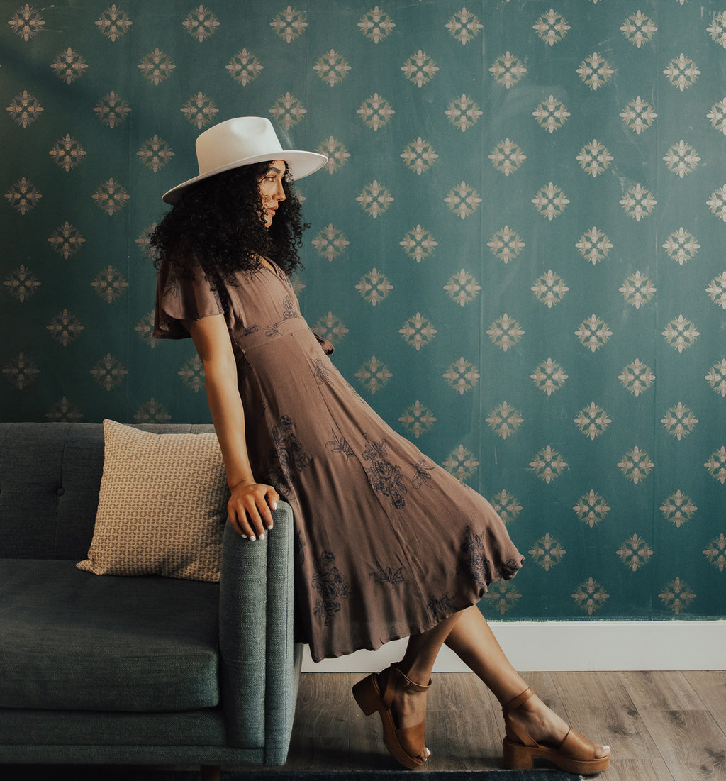 The Beverly Embroidered Wrap Dress in Brown, lifestyle shoot; side view