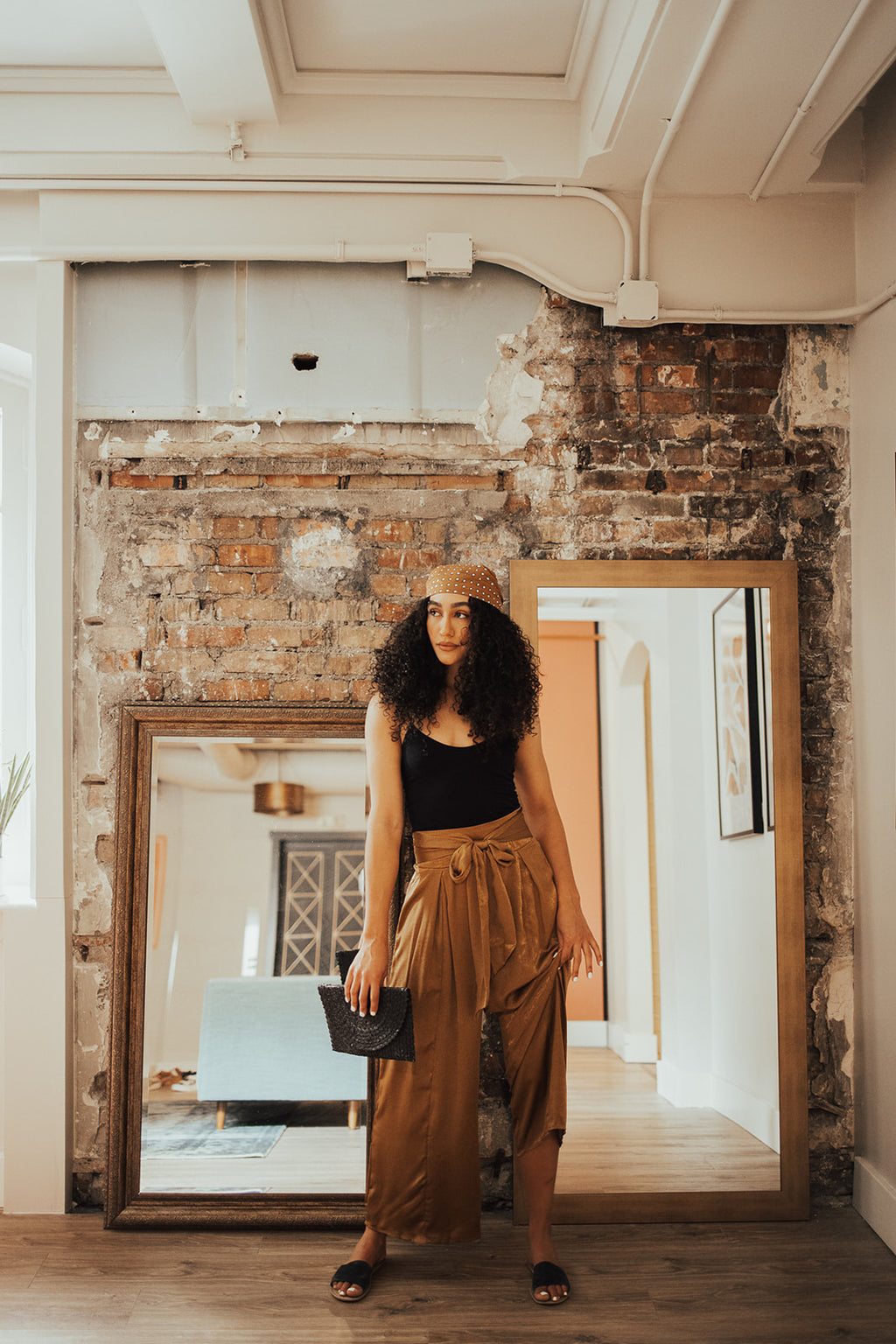 The Quinn Wide Leg Trouser in Gold, lifestyle shoot; front view