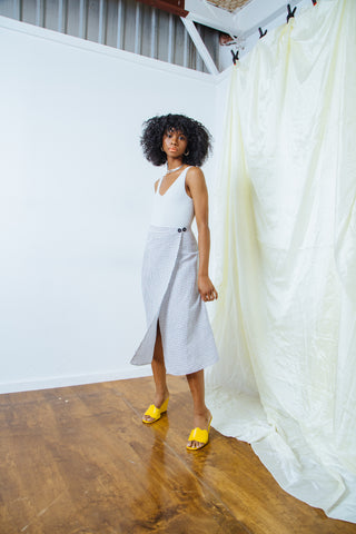 Ali Golden Grid Wrap Skirt, Maryam Nassir Zadeh Yellow Wave Wedge, Baserange Grey Aid Bodysuit
