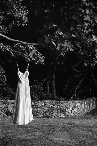 Hanging Dress and Stone Wall