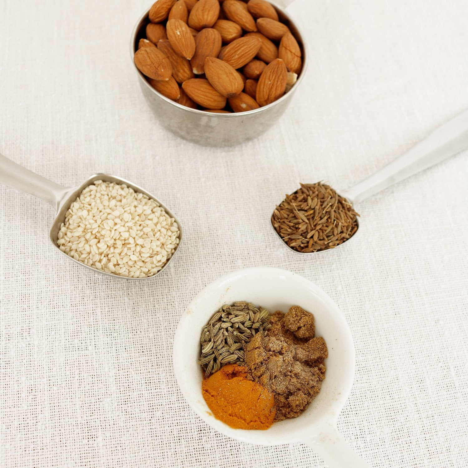 dukkah ingredients almonds sesame seeds cumin tumeric cardamom Camille Co. recipe blog post