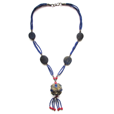 Lapis Antique Orb Tassel Necklace beaded tassel with coral accent hang from an antiqued orb finished in indigo beads and Lapis stations