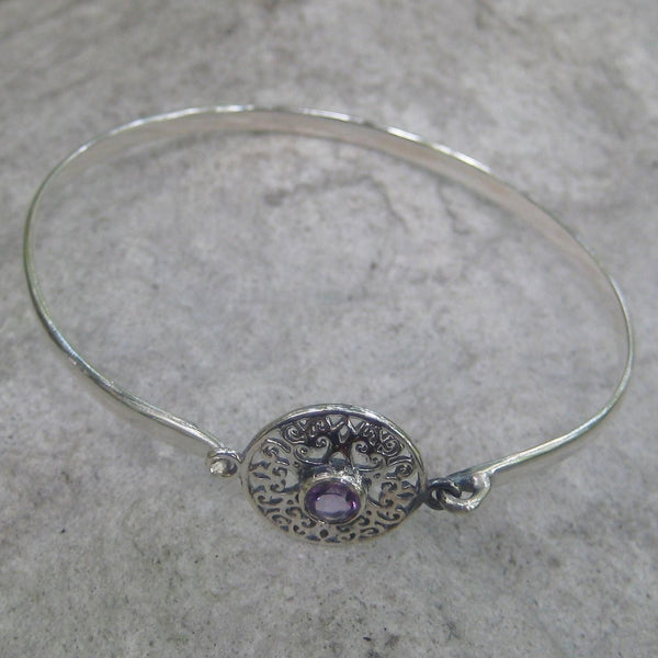 Sterling Silver Amethyst Celtic Bracelet  features an amethyst gemstone at the center of the Celtic heart knot design face