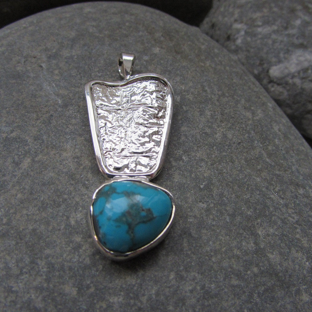 Sterling Silver Aztec Azure Turquoise Pendant Inspired by Aztec motif this pendant features a hammered wave styled plate finished with a natural turquoise gemstone