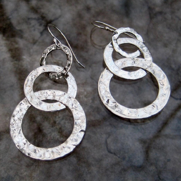 Sterling Silver Graduated Circle Dangle Earrings.  These hammered silver earrings feature dangling graduated circles creating delightful movement and reflecting light