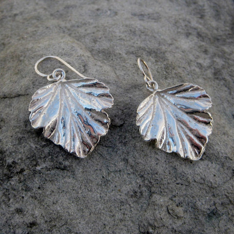 Sterling Silver Leaf Drop Earrings crafted in Sterling Silver feature a Raspberry Latte Tree Leaf Motif finished with a french wire