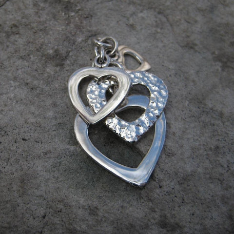 Sterling Silver Multi Heart Pendant features four Sterling Silver graduated cascading hearts in polished and hammered finish