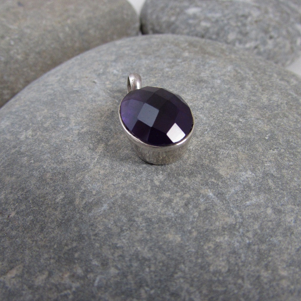 features a generous size dome shape, faceted amethyst gemstone side view shows the generous size of the pendant
