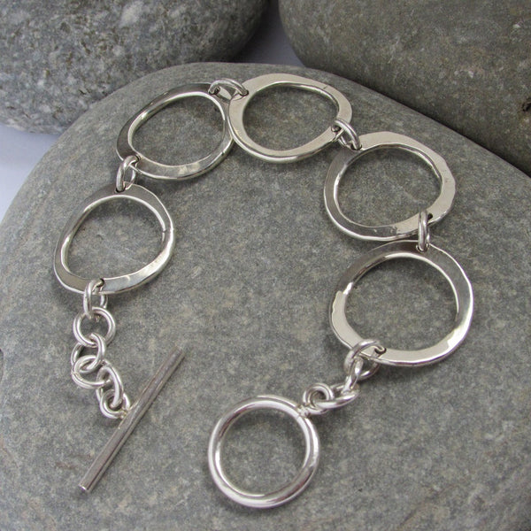 Sterling Silver Circle Link Bracelet features hammered circles connected with a single link giving the bracelet more flexibility