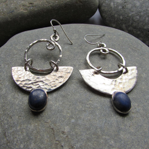 Sterling Silver Half Moon Lapis Earrings are crafted with Lapis and Sterling Silver featuring a half moon shape with a dimpled surface