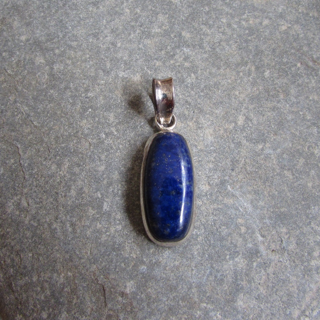 Sterling Silver Lapis Cabochon Pendant  features a cabochon shaped Lapis Lazuli gemstone set in sterling silver
