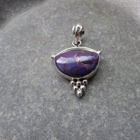 Sterling Silver Purple Copper Turquoise Pendant features a generous size half moon shaped cut Purple Copper Turquoise gemstone finished with silver honeycomb motif