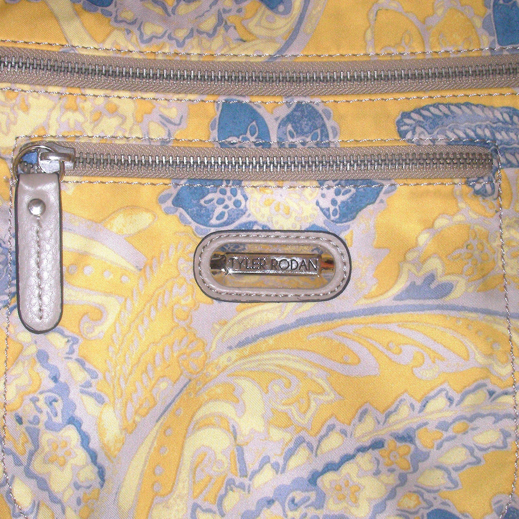 Tyler Rodan Kansas Cross Body Bag Closeup Of Print and Logo