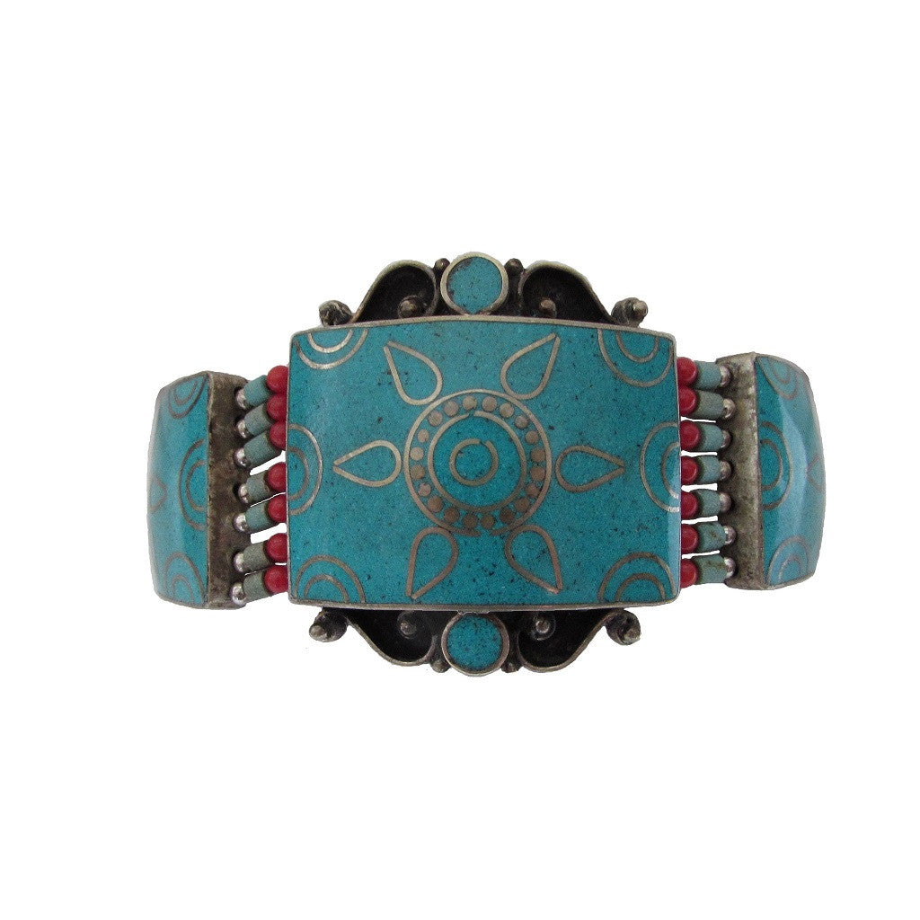 Turquoise Metal Work Bracelet 'Zar' in silver tone metal and turquoise with coral bead accent  features a sectional inlay of turquoise with delicate filigree design in silver tone