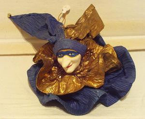 Harlequin jester ornament with blue mask and blue gold ruffle.