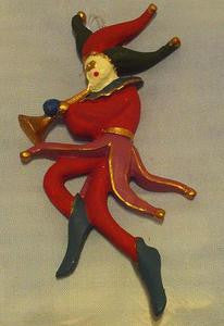 Red, green and gold harlequin trumpeter ornament.