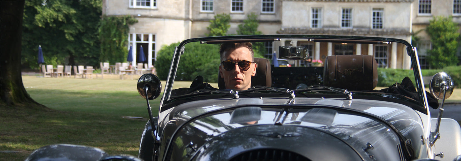 Man driving a Morgan Motor's convertible