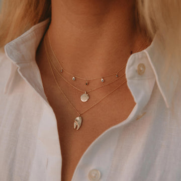 endless ocean blue sapphire necklace on body}