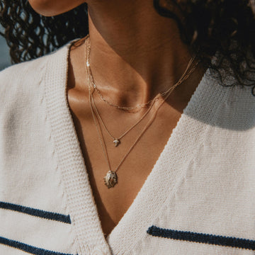 shore keeper shell pendant necklace on body}