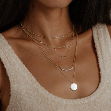 Everyday Little Crescent Moon Necklace on body}