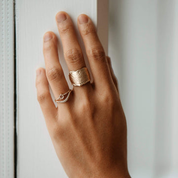 bold, textured band of 14k gold ring hand carved melting honey texture With an asymmetrical design