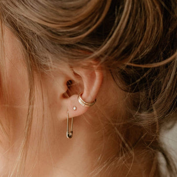 safety pin earring on body}