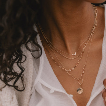 equinox ying yang charm + kindred wanderess chain necklace duo on body}