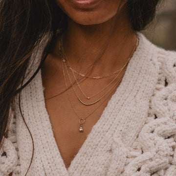 love bug charm + essential necklace duo on body}