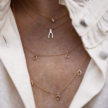 honey dipper necklace on body}