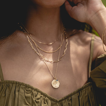 tree of life ancient coin medallion necklace on body}
