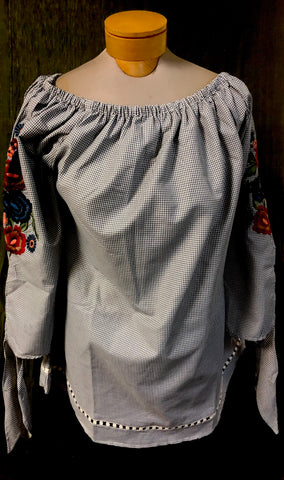 Andre style embroidered peasant style blouse. Price is 50% off our regular price.  Avani Del Amour label