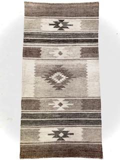 This handwoven rug is a design inspired by Navajo rugs.  It has several tones from the lightest grey to a medium grey.